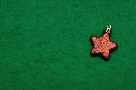 A christmas tree decoration in the shape of a red star Stock Photo