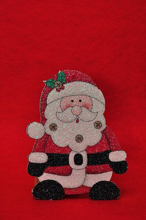 A christmas father figurine against a red background