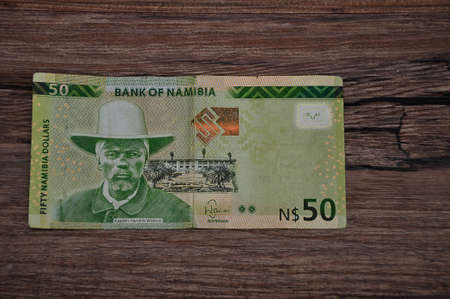 Roodepoort , South Africa 27 March 2020. A fifty dollar Namibia banknote on a wooden background. Editorial