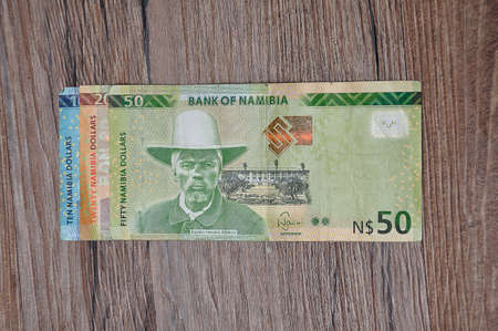 Roodepoort , South Africa 27 March 2020. A display of different Namibia dollars on a wooden background.