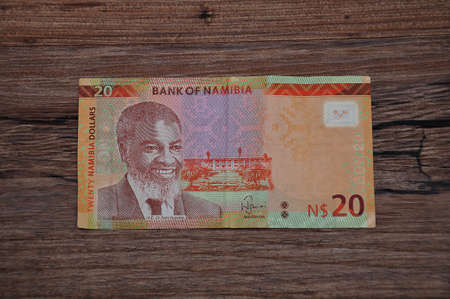 Roodepoort , South Africa 27 March 2020. A twenty dollar Namibia banknote on a wooden background.
