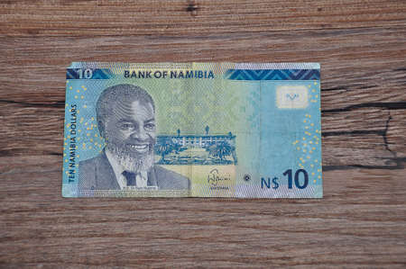 Roodepoort , South Africa 27 March 2020. A ten dollar Namibia banknote on a wooden background.