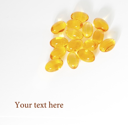 Oil vitamins yellow capsule on the prescription blank photo