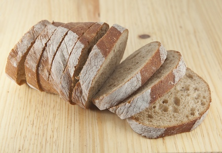 Fresh bread sliced on the wooden  board photo