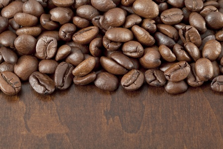 Coffee beans on the wooden background photo