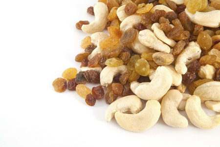 energy mix: Mixed nuts and raisins on the white background close up