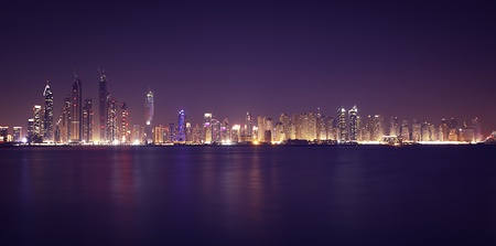 Dubai Marina in the night. Panoramic view from gulf photo