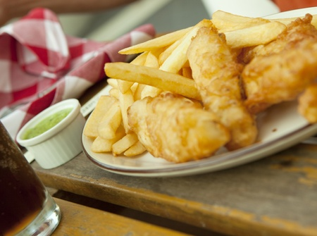 chips: Fish and chips. Traditional british snack on the wooden table
