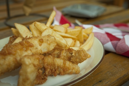 Fish and chips  Traditional british snack on the wooden table Stock Photo - 12751078