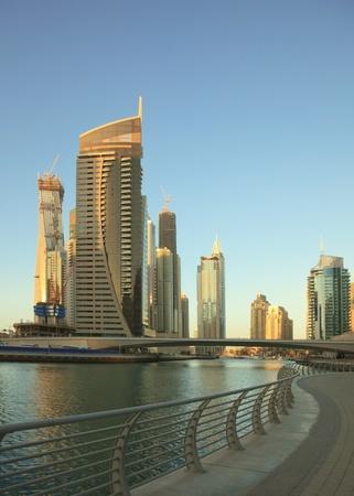 water scape: Dubai Marina. Cityscape before sunset. Panoramic scene.