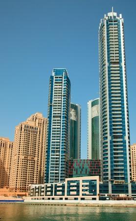 sheik: DUBAI, UAE -  MARCH 09: Dubai Marina district  on March 09, 2012 in UAEi. Al Fattan Marine towers with Sheik portrait on the top