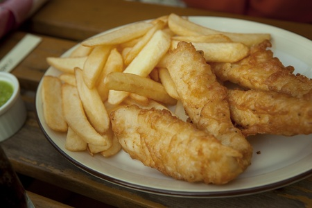 Fish and potato chips on the table Stock Photo - 12751483