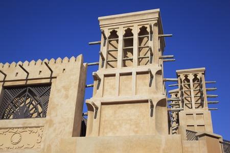 cooling tower: Arabic wind tower against a blue sky background
