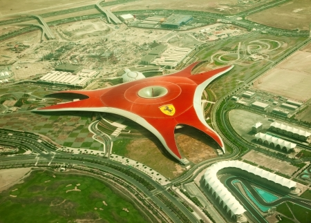 ABU DHABI, UAE -  APRIL 07  Ferrari World Park is the largest indoor amusement park in the world  The roof has a total surface area of 200,000 m2   Abu Dhabi on April 07, 2012  Bird Editorial