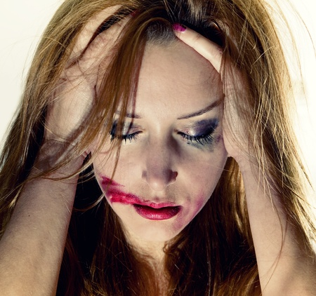 Emotional portrait of the young depression woman with with flowing makeup photo