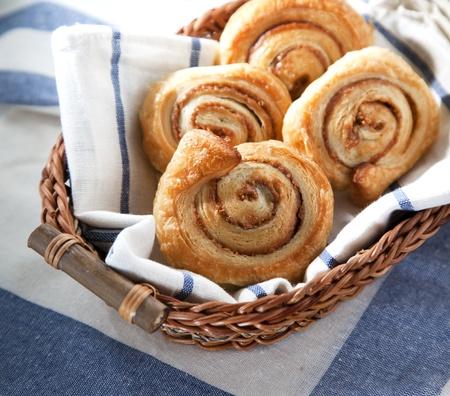 Cinnamon danish bun in the basket  on textile  background photo