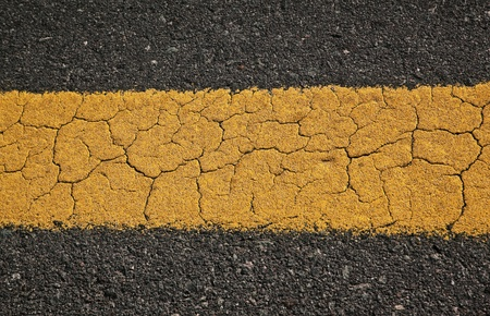 Asphalt road texture background  with yellow strip  photo