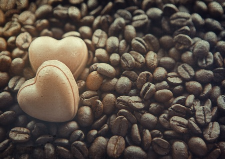 Chocolate sweets hearts on the coffee beans background  Old image style photo