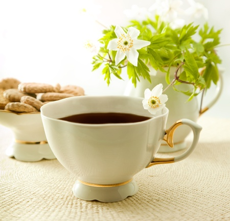 Cup of tea with cookies and flower as background Stock Photo - 13595522