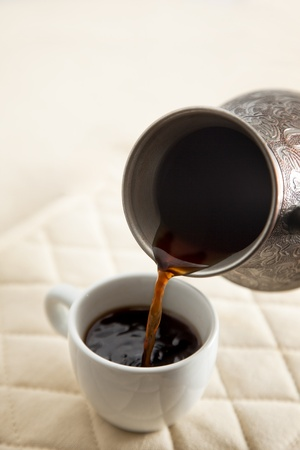 Pouring coffee into white cup Stock Photo - 13595511
