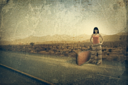 old suitcase: Young woman with suitcase on the road. Old style image