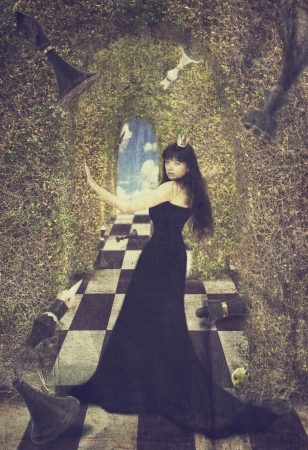 Young woman as black chess queen. Fairy tail image. Old style photo
