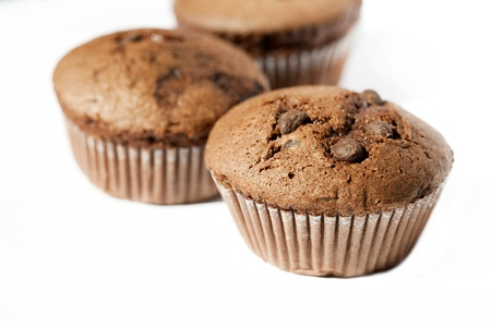 sweetmeats: Chocolate muffins on the white background