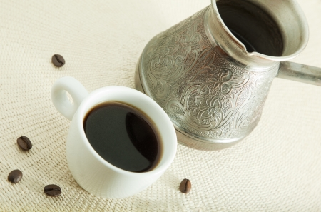 coffee pot: Cup of coffee with beans and arabic coffee pot