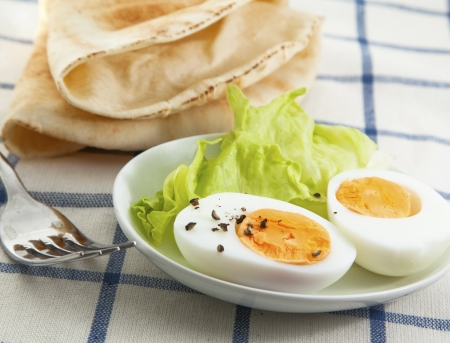 hard boiled: Hard boiled egg with salad on the textile background