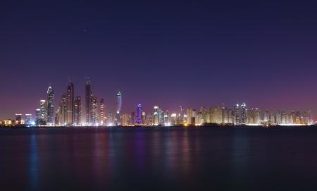 Dubai cityscape in the night photo