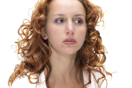 Woman with red hair on the white background photo