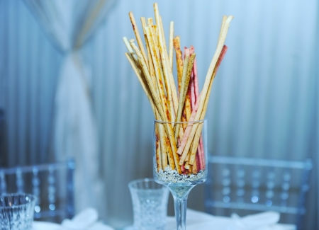 Bread sticks in  the glass  photo