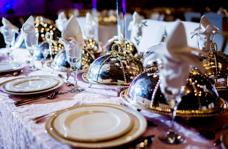 arrangment: Wedding table arrangment. Luxury catering table  service with dish silverware