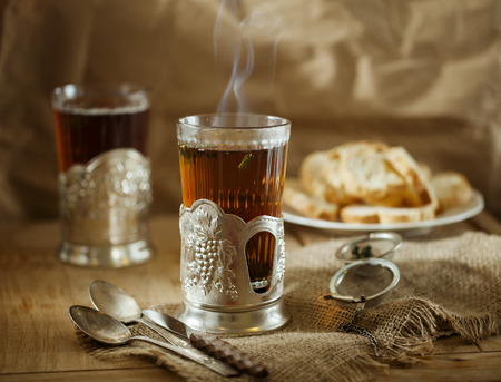Glass of tea on wooden table in Soviet style glass holder