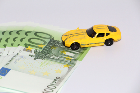 Car loan. Car on the background of currency. Money can be taken in the bank. The picture is not a background. Stock fotó