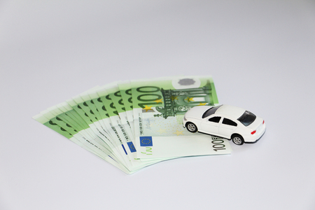 Car loan. Car on the background of currency. Money can be taken in the bank. The picture is not a background.