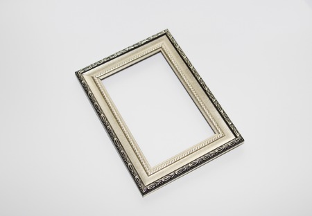 Aged frame for a photo, picture or certificate. Photo on a white background. There is nothing in the frame. Foto de archivo