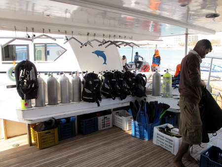Underwater diving equipment. Many diving cylinders. Boat to sail. On the boat equipment for divers.
