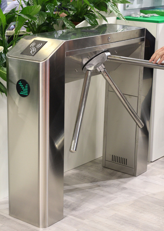 Turnstile for the passage of people. Entry exit, identity check. Security. Control check baggage and documents. Banque d'images - 120648025