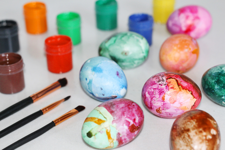 Painted Easter eggs. Special paint for Easter eggs. Paint eggs with paint and whale. Marble colored eggs. Pastel shades.
