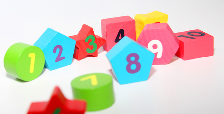 Wooden figures with numbers 1, 2, 3 ... and 10. Wooden cubes with numbers for children. Learn numbers for kids. The development of young children. White background