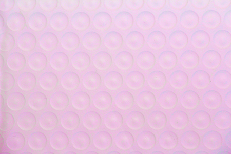 Corrugated pink texture with circles. Background for cards. Template for lettering. Pink color.