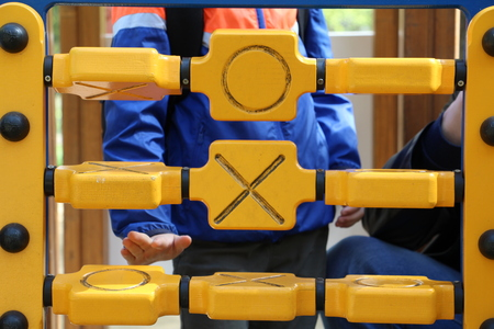 Tic tac toe game. Play in the park. Spending leisure time with children in the park.