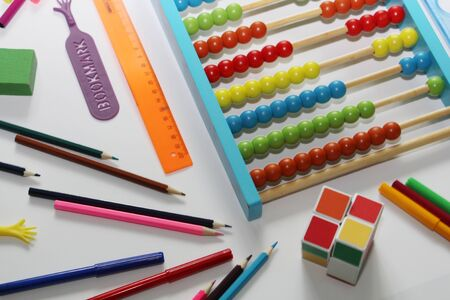 Soon back to school. Colored abacus, rulers, pencils and pens. Preparation for school. September 1. School set of items for the student.