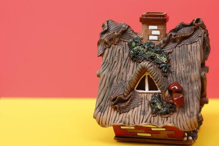 Fairytale house - a hut. The background is bright. There is a place for text. Banque d'images