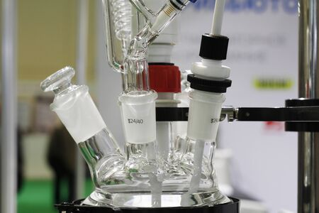 Chemical laboratory in which experiments are carried out. Flasks and test tubes stand on devices for chemical synthesis.