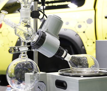 Devices for chemical synthesis in a chemical laboratory. Conducting experiments. Equipment in the laboratory. Test tubes and flasks are on the apparatus of chemical synthesis.