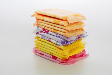 A lot of feminine sanitary pads in the package. Gaskets are stacked on top of each other. Gaskets for monthly use. Hygiene. Standard-Bild - 131921028