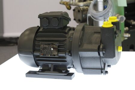 Cutaway high vacuum compressor. Vacuum pumps and systems in a manufacturing facility. Vacuum units - forevacuum and valve.
