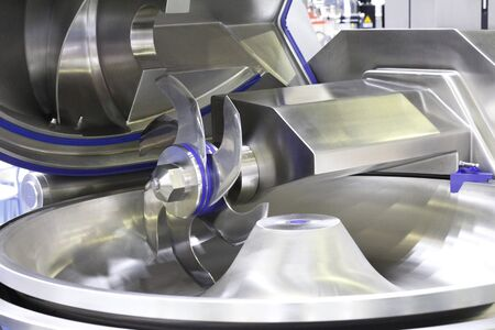 Cutter for chopping meat at a meat processing plant. Industrial cutter at the factory where sausages are made. Huge stainless-steel pars for meat processing. Industrial equipment. Food industry.